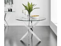 Novara Chrome Round Glass Dining Table selling at £60