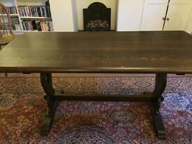 Dark oak dining table with great charm