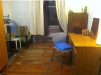 Inexpensive room in the city centre in a flat with two friendly professionals.