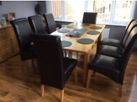 Wooden table & 8 high back chairs , table can dismantle & fit in any estate or hatchback car