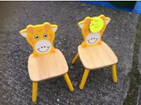 pair of childs giraffe chairs