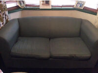 green two seater sofa bed! good quality!