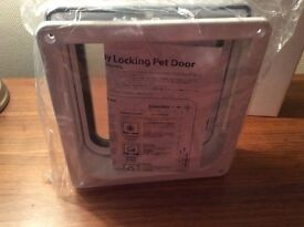 4 WAY LOCKABLE CAT OR SMALL DOG FLAP = BRAND NEW!