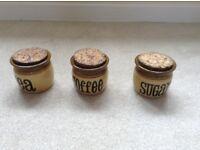 Tea, coffee, sugar and biscuit jars