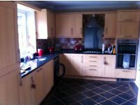 Shaker style kitchen beech effect wall & base units with real granite work top