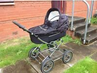 Pram with changing bag , winter muff and sun canopy
