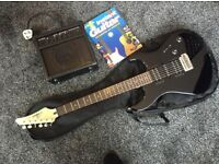 Yamaha erg 121 electric guitar and 10amp practice amp and learn to play book