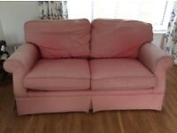 Free two-seater sofa, worn and marked, still comfortable. From non-smoking home