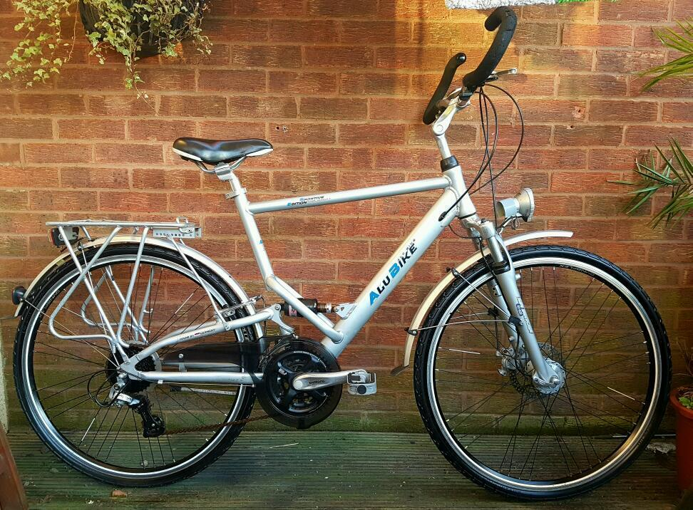 Alu bike mans,front discbrake,700c wheels,24 speedin Wolverhampton, West MidlandsGumtree - Hi for sale Alu mans bike,made in Germany, discbrakes at front,v brakes at rear,dynamo front and rear lamps,24 speed,dual suspension,700c wheels,new tyres,chain guard,rear carrier and gel seat,mudguard.this is a high quality bike and very well...