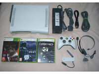 Xbox 360 with 60gb hdd, wireless controller, games, headset and wireless internet adapter!!