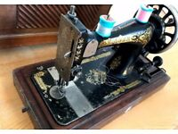 Vintage Singer Sewing Machine in wooden case