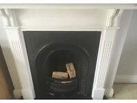 Cast iron fireplace and white surround - £150.00