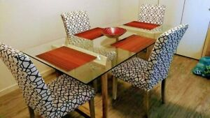 Modern glass and wood dining table with 4 chairs