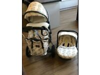 Silver cross travel system.