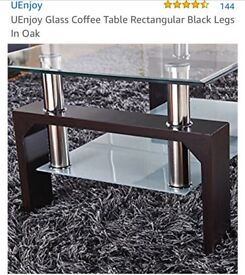 Two tiered glass coffee table. New boxed and Unused