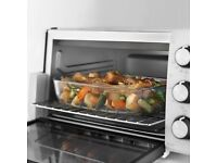 BRAND NEW TABLE TOP OVEN by DELONGHI E12012W - ELECTRIC - STILL BOXED - COST £99.99 - ACCEPT £50