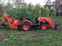Compact tractor with bachoe services
