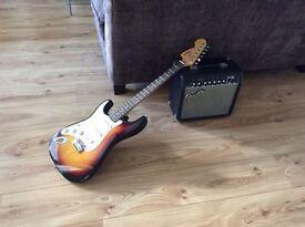 Fender Squier Strat (left-handed) and Fender Frontman 15R amp