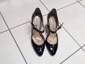 Black patent leather Jimmy Choo shoes, size 5 and a half