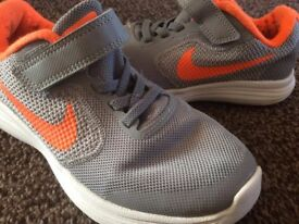 nike revolution grey orange uk13