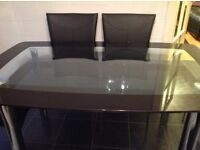 Glass Kitchen table for sale . Sale as seen. Buyer must collect