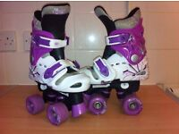 Osprey white & purple adjustable roller boots size 10-13