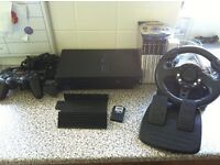 Playstation 2 Console, steering wheel and peddals and 6 games