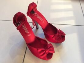 Red satin heels, size 5