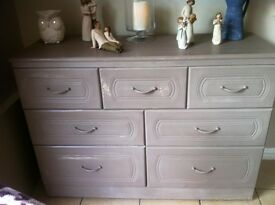 large solid chest of drawers on wheels and very deep storage drawers