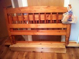 solid wood double bed ex con slept in once only & bedside cabinets x 2