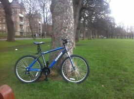 MOUNTAIN BIKE, EXCELENT CONDITION, IT WAS BARELY USED, FRONT SUSPENSION