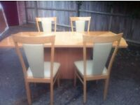 Big wooden dining table with 4 chairs. Delivery provided if needed.
