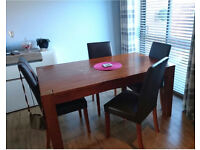 Solid oak wooden table with 4 faux leather chairs