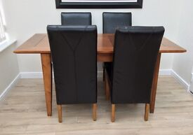 Extending Table & 4 Roll Top Faux Leather Chairs lovely condition