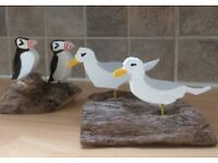Two Seabirds on driftwood base (EITHER puffins or seagulls)