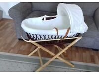 Lovely moses basket with stand and bedding.