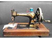 Vintage Singer hand crank sewing machine.