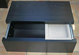 IKEA black storage box or boxes with shelf and handles.