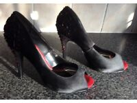 Ladies &TV/CV Intrest size 8 sparkly heeled ,black peep toes ,red sole , worn but well looked after