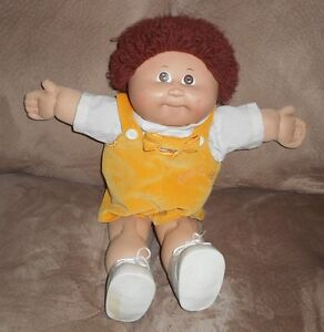 Vintage Cabbage Patch Kid doll with outfit