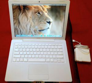 Apple Macbook White with a 500 gb HD - 4GB RAM