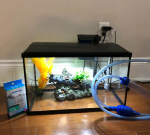 20 gallon fish tank with heater, pump, filter, lights,vacuum