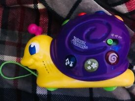 Musical Pull Along Snail Toy