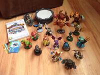 Bundle of 17 skylander figures, including wii game and portal £ 15 hardly used