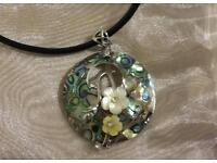 Pretty Shell Pendant on leather cord
