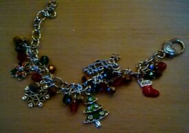 Hand made Christmas charm bracelet with enamelled and rhinestone charms. Great gift/ stocking filler
