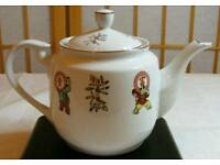 Oriental teapot white porcelain with colourful figures and golden highlights