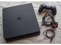 Boxed - Black PS4 with DualShock Wireless Controller and 2 games included.