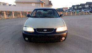 REDUCED PRICE! 2002 Nissan Sentra. 2 sets of rims/tires! LOW KM