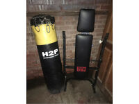 Punching bag and weight bench